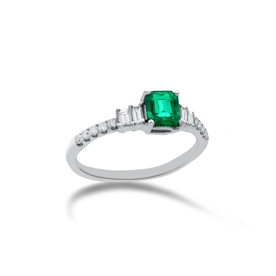 Emerald Ring set in 18k with Diamonds