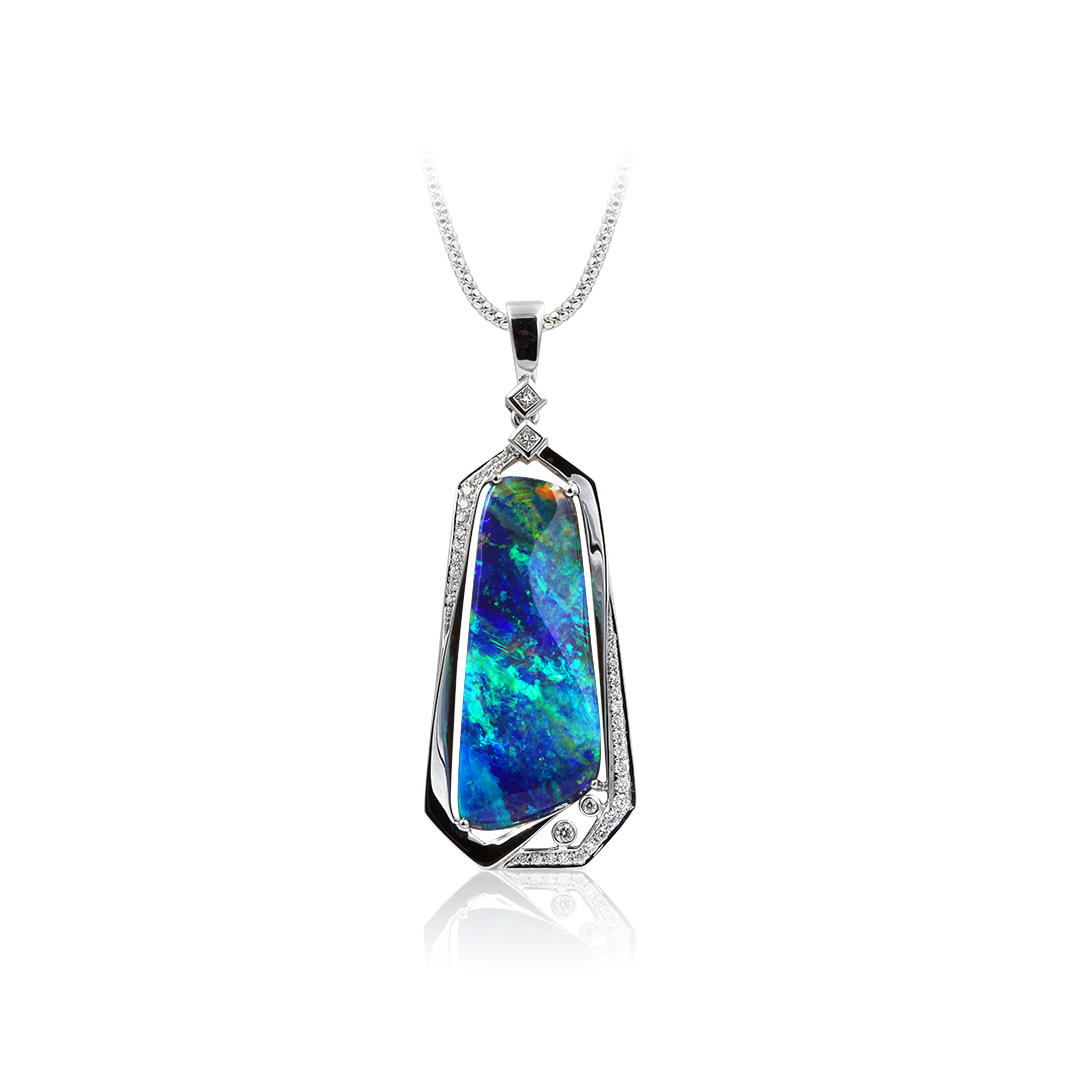 Boulder Opal Pendant set in 18k  with Diamonds displaying a Tapestry of Colours