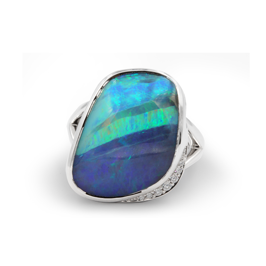 Boulder Opal Ring set in 18k with Diamonds exhibiting Ribbons of Colour