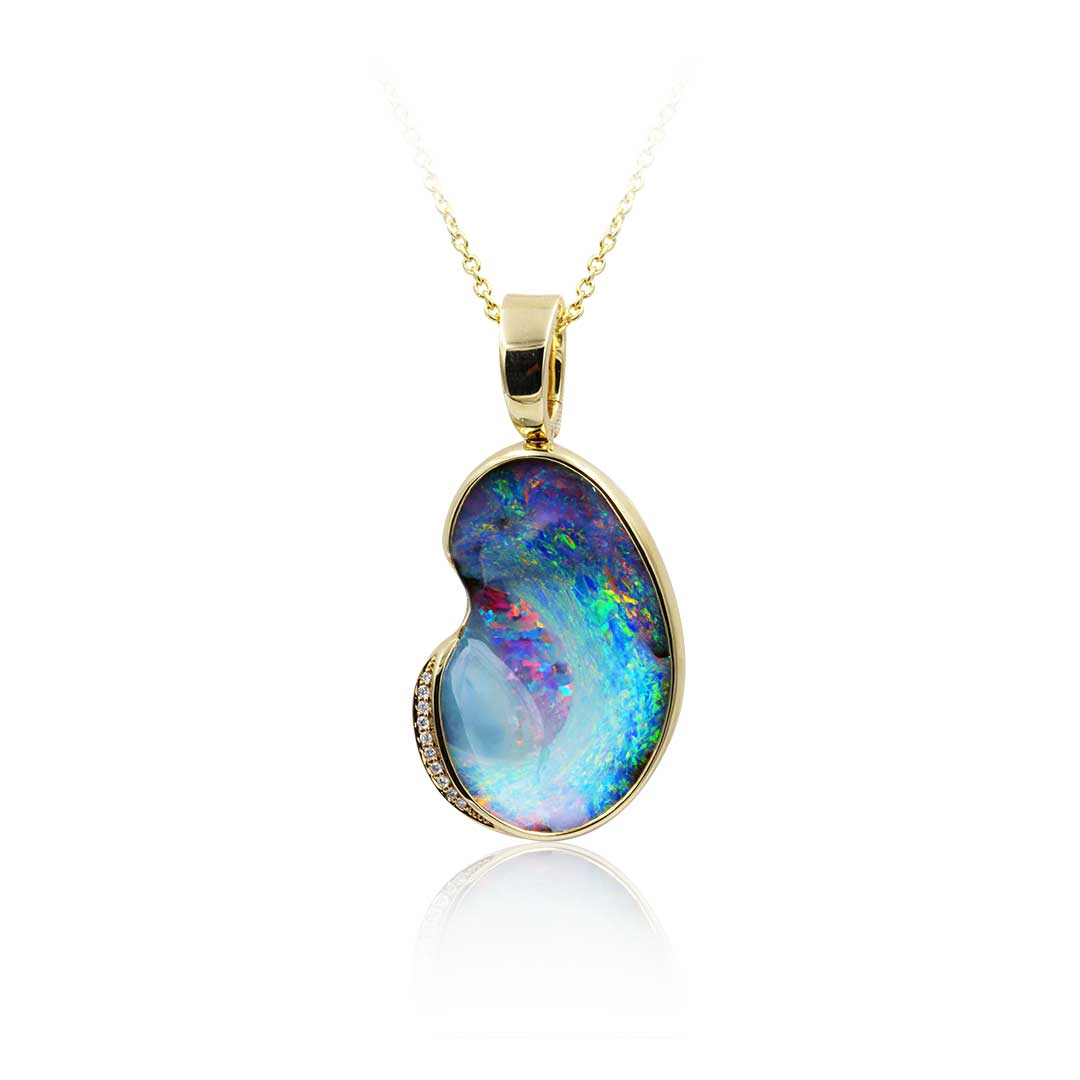 Boulder Opal Pendant set in 18k displaying The Celestial Sky