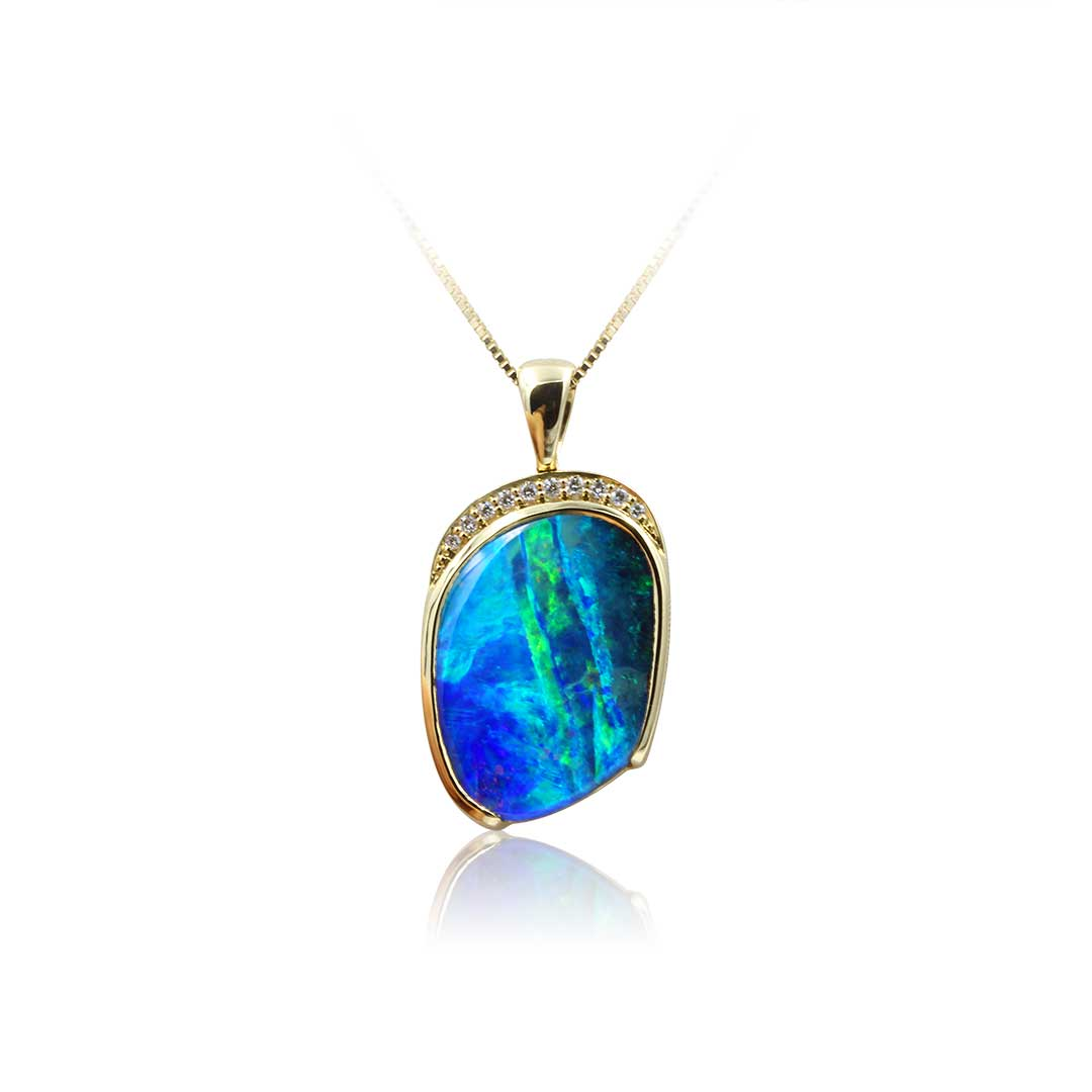 Boulder Opal Pendant set in 18k featuring Ribbons of Blues and Greens