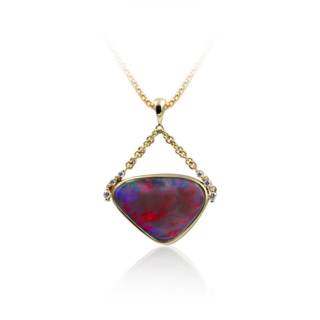 Black Opal Pendant set in 18k displaying Colours of A Desert Sunset