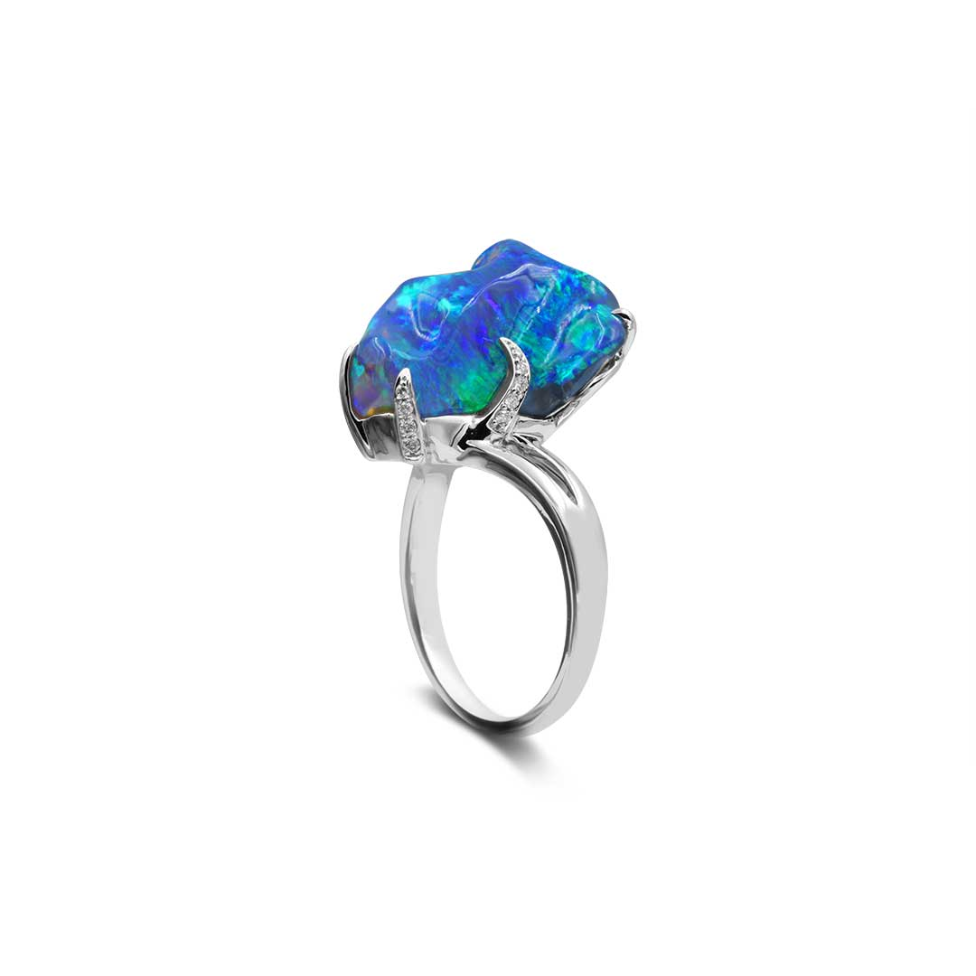 Black Opal Ring set in 18k with Diamonds displaying Waves of Blues and Greens