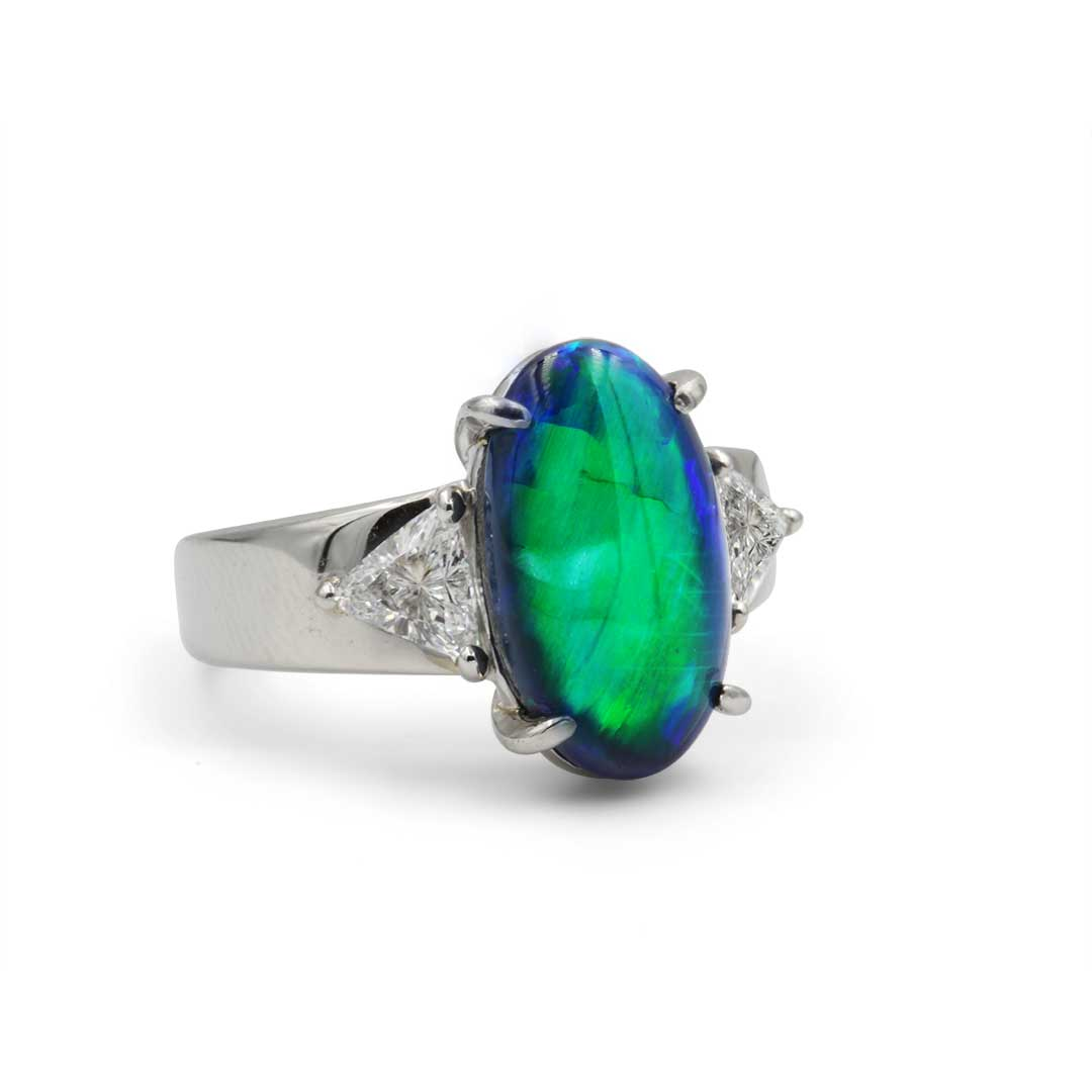 Black Opal Ring set in Platinum with Diamonds displaying A Broad Flash of Brilliant Green