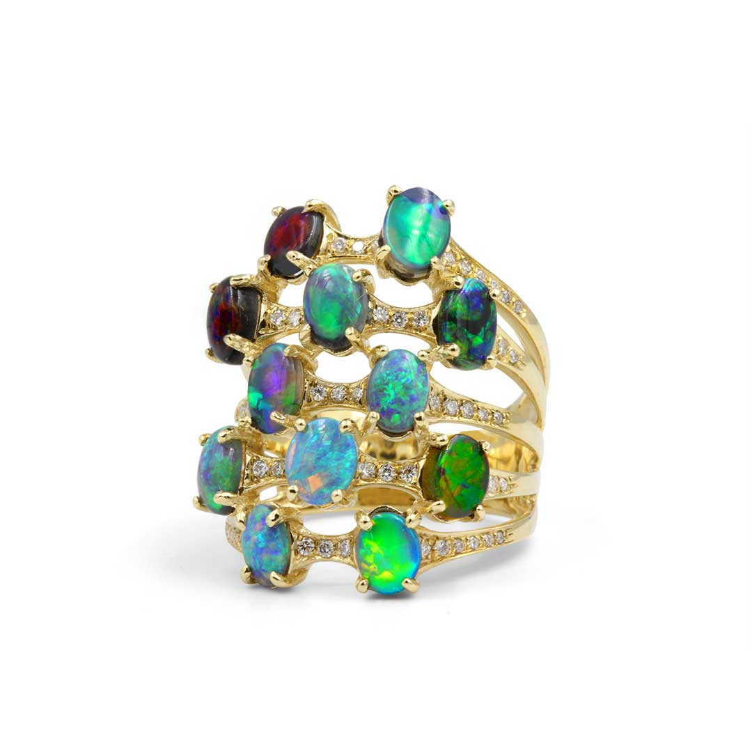 Black Opal Ring set in 18k with Diamonds displaying Rolling Flashes of Peacock Colours