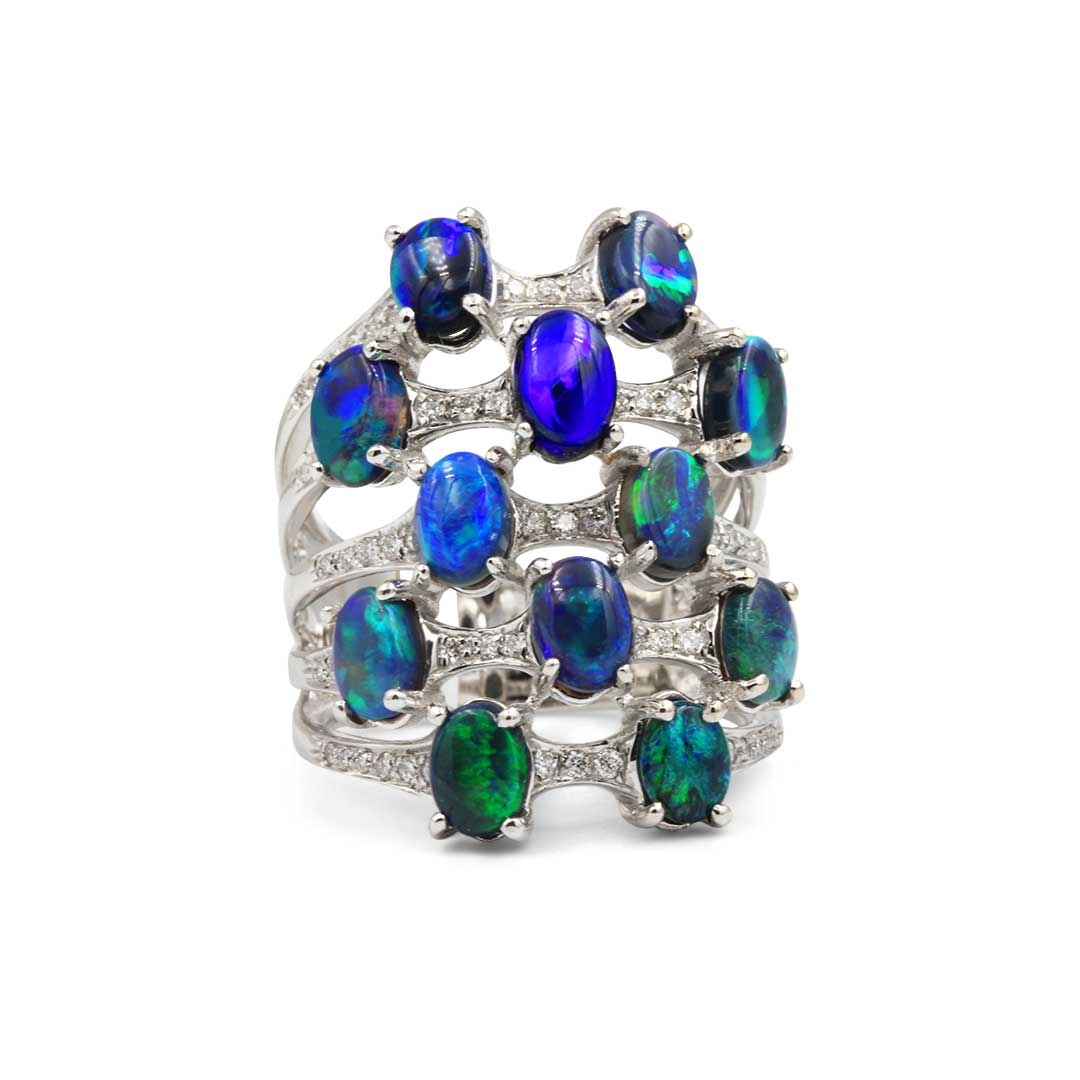 Black Opal Ring set in 18k with Diamonds featuring Mysterious Ocean Colours
