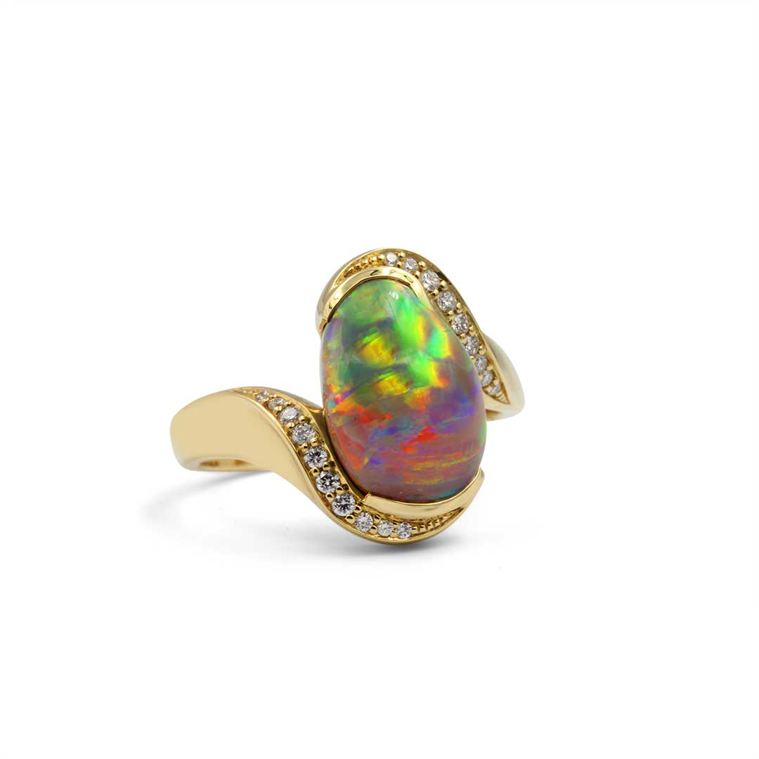 Black Opal Ring set in 18k with Diamonds displaying Rolling Flashes of Red, Green and Orange