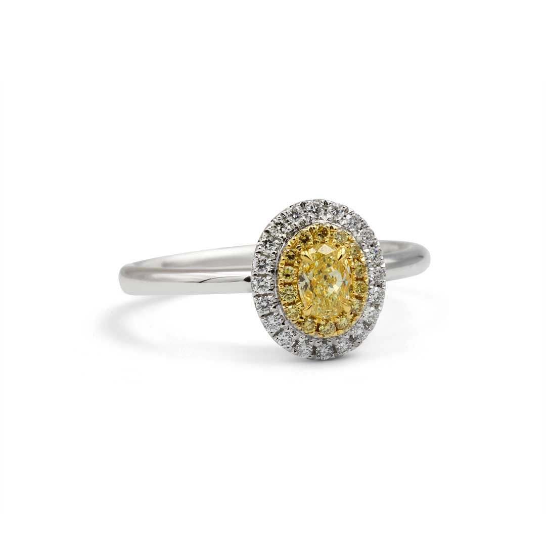 Oval Yellow and White Diamond Ring set in 18k