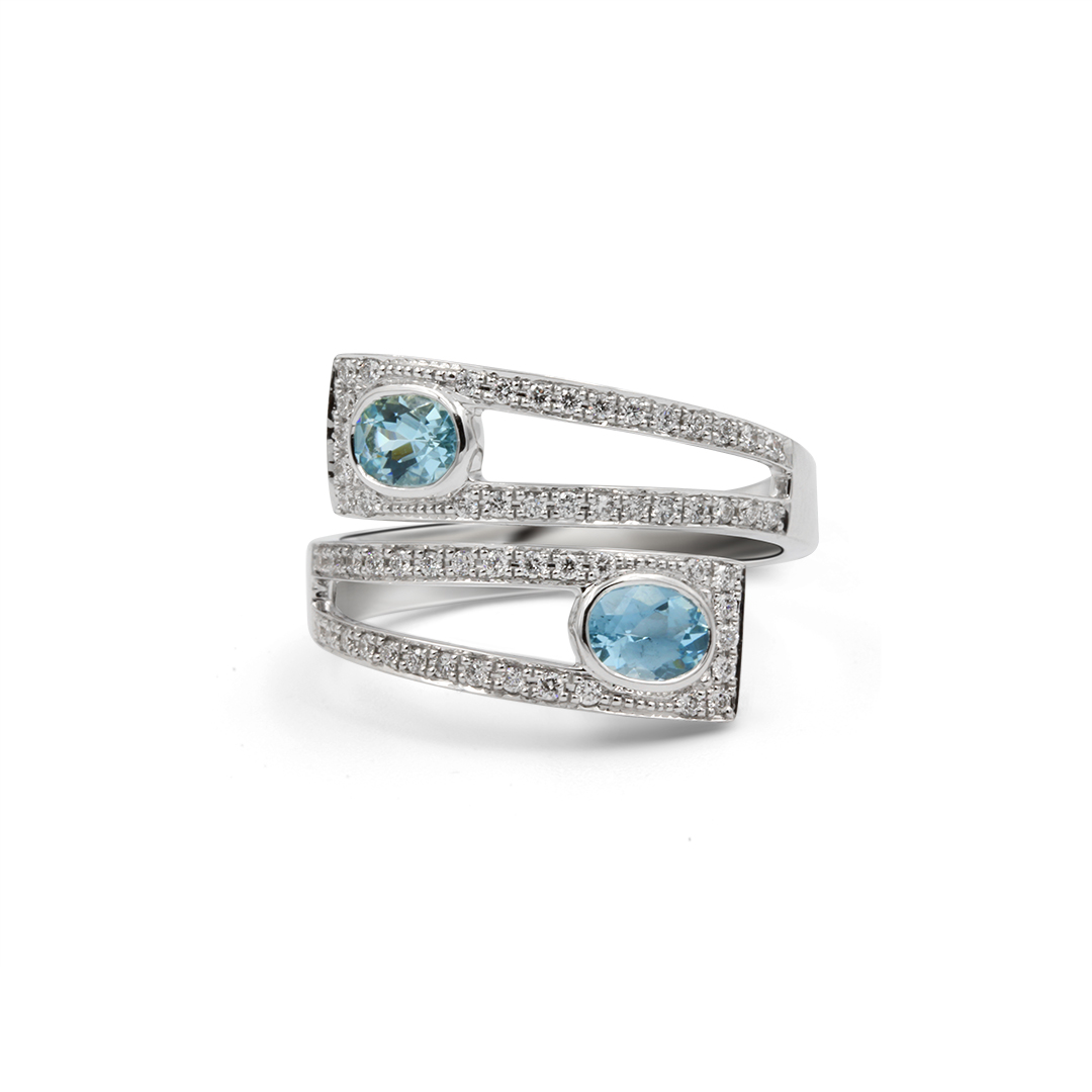 Aquamarine Crossover Ring set in 18k with Diamonds