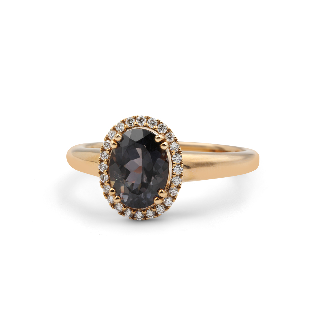 Oval Shape African Sapphire Ring set in 18k with Diamond Halo