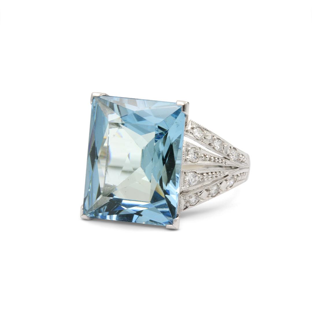 Aquamarine set in 18k with Multi Diamond Bands