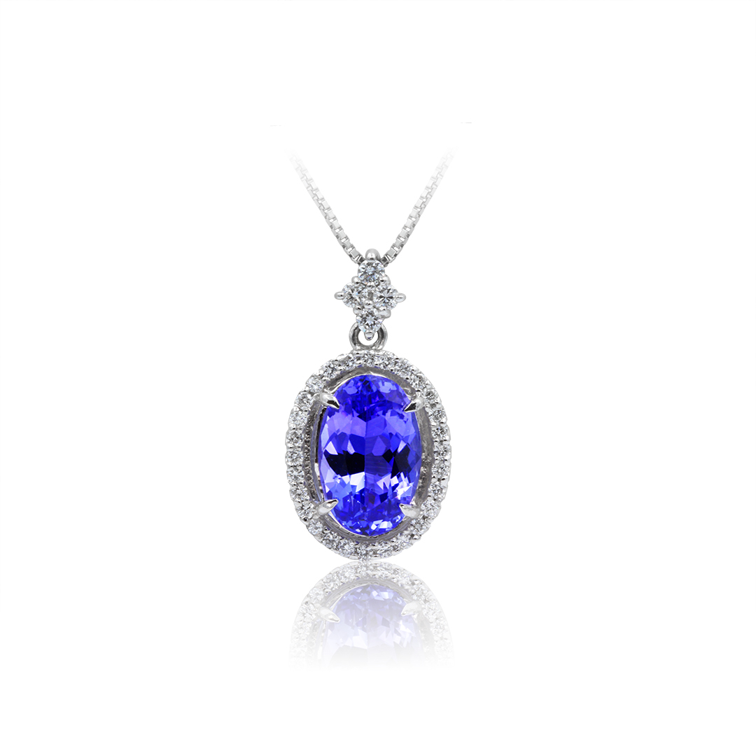 Oval Shape Tanzanite Pendant set in Platinum with Diamond Halo