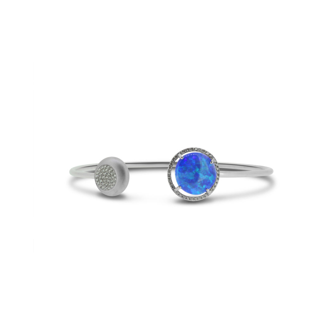 Black Opal Bangle set in 18k with Diamonds displaying Sea Blues