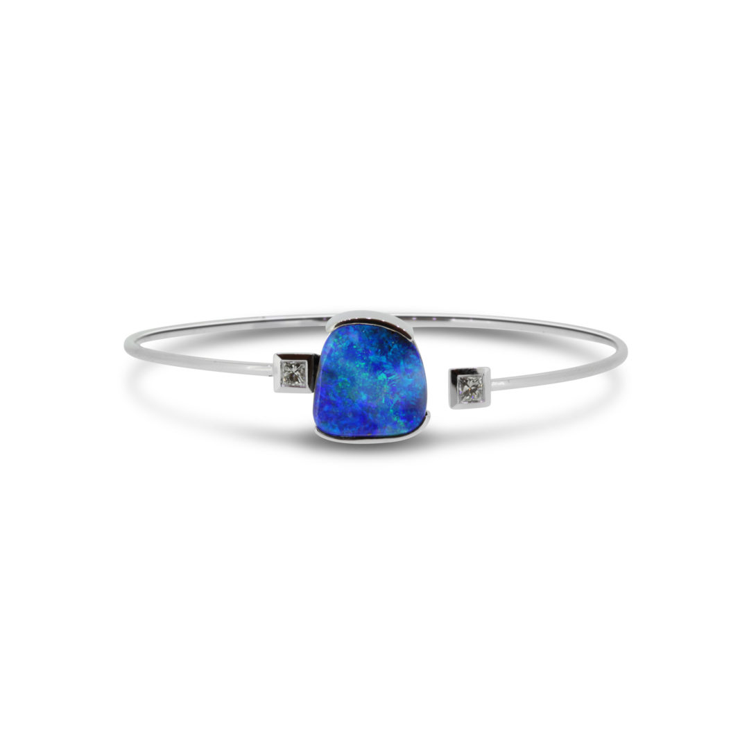 Boulder Opal Bangle set in 18k with Diamonds displaying Ocean Blues