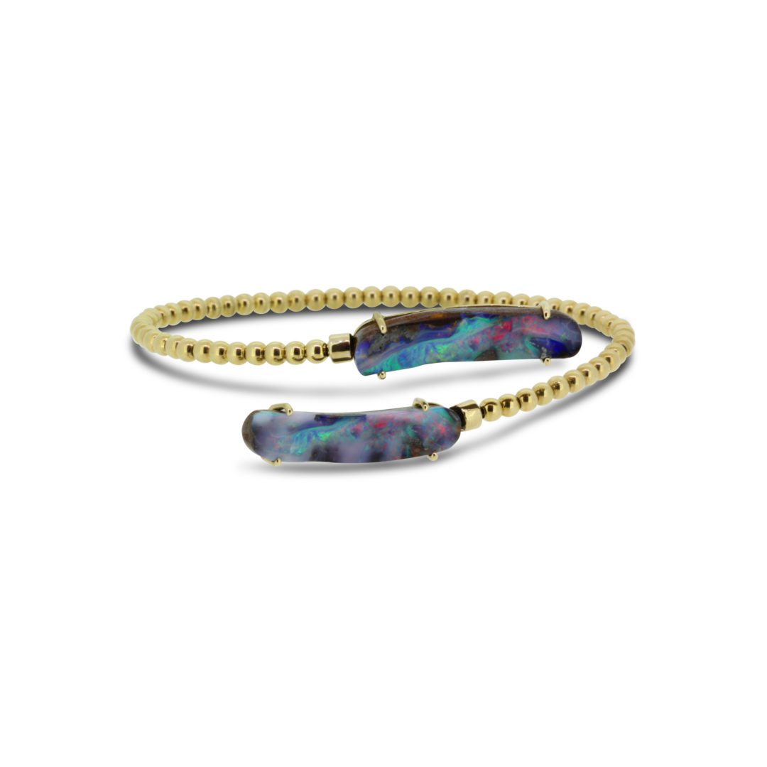 Boulder Opal Bangle set in 18k displaying Ocean Flashes of Red, Blue and Green