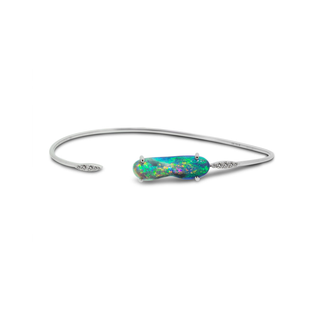 Black Opal Bangle set in 18k with Diamonds displaying Flashes of Multi Colours