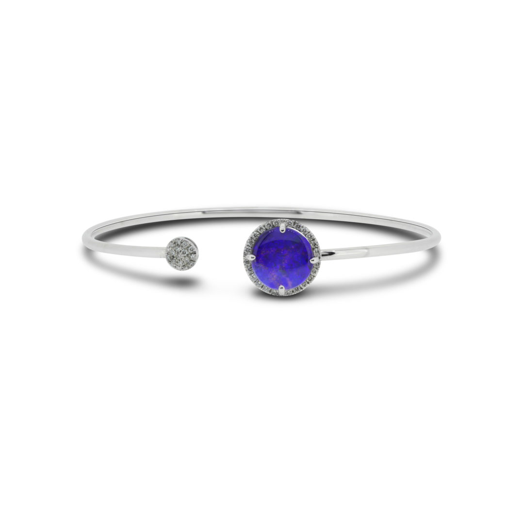 Boulder Opal Bangle set in 18k with Diamonds displaying Violet Colour