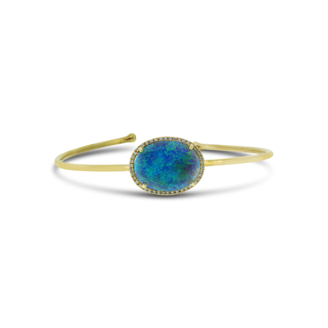 Black Opal Bangle set in 18k with Diamonds displaying Rolling Flashes of Blues and Greens